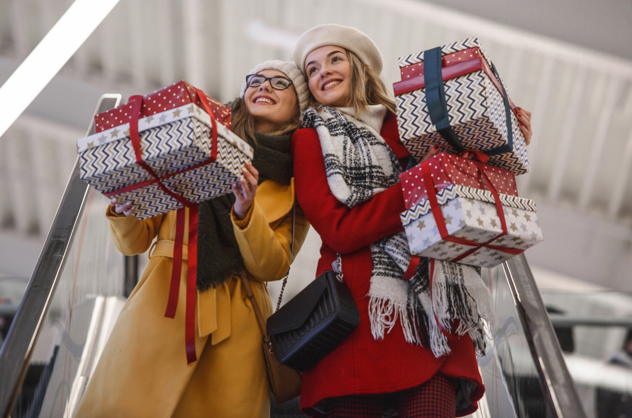 Women carrying Christmas gifts at the shopping mall
