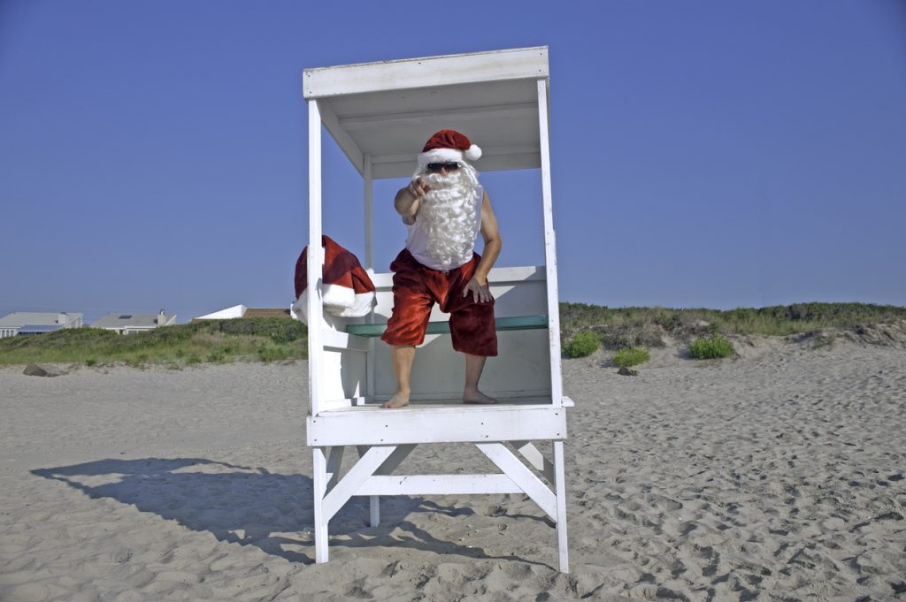 Santa Clause as a lifeguard on the beach