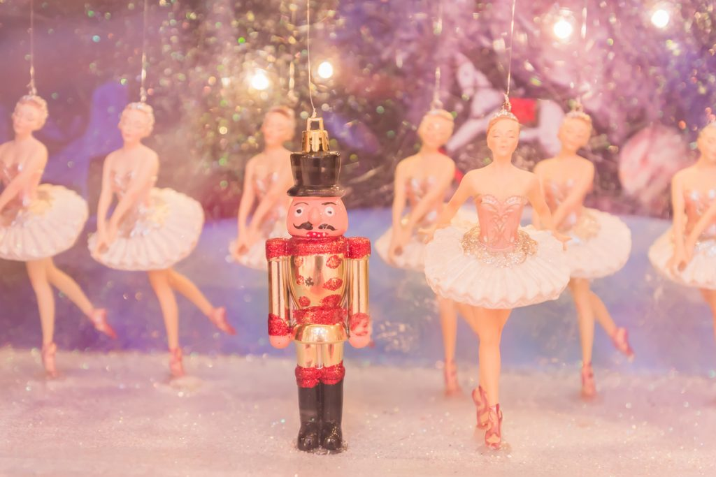 Christmas nutcracker toy soldier and balerina dolls on the stage. Famous Russian Ballet installation.